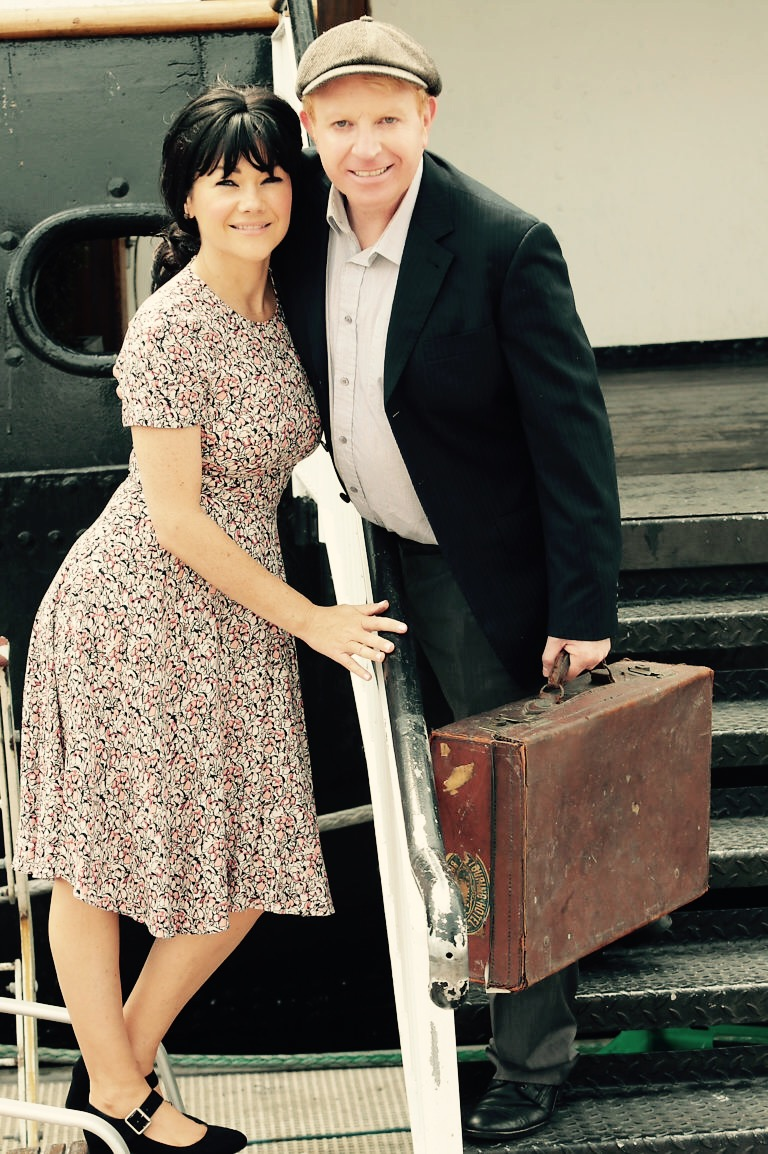 """Actress Michelle Lally with Tommy Fleming  pictured at North Wall Dublin when he announces details of his forthcoming musical PADDY which will touch down at the  Bord Gáis Energy Theatre on September 20th, 2016.   Picture :Brian McEvoy No repro fee for one use  Tommy Fleming steps back in time to 1960's Ireland to bring his lead character Patrick Murphy to life, in a reimagined scene from the musical – dressed in typical attire from the era:  flat cap and tweed suit, Patrick Murphy makes his way across the Irish Sea by boat on the CV Cill Airne to start a new life in London. Leaving his sweetheart Kathleen played by Michelle Lally behind.      PADDY COMES TO THE BORD GÁIS ENERGY THEATRE FOR THREE NIGHTS FROM 20THSEPTEMEBER TO 22ND SEPTEMBER 2016 AND TICKETS ARE AVAILABLE NOW PRICED FROM 15EURO WWW.BORDGAISENERGYTHEATRE.IE     MORE ABOUT PADDY:   Written by Tommy Fleming with singer/songwriter Gerry Carney and writer Tommy Marren,  the two-hour production tells the story of Irish emigrant Patrick Murphy – played by Tommy Fleming – who leaves Mayo in the 1960's in search of fame and fortune in London.   With a gripping storyline that is set in both Ireland and England over a 25-year period – alongside 13 original songs – 'Paddy' promises to be a unique night of  drama and  music.  International multi-award winning singer Tommy Fleming takes to the stage for his first major acting role in self pennedmusical Paddy.  The cast of 10 also includes Deirdre O'Meara, Mary Marren and Eileen Slevin.  Tommy Fleming is one of Ireland's most popular and successful artists and his involvement in 'Paddy' is seen as a natural progression in a career that has seen him perform sell-out solo concerts in Ireland, the UK, America and Australia as well as performing alongside artists like Phil Coulter, Kenny Rodgers and Elaine Page.  For Director Tommy Marren, the project comes on foot of his hugely successful production of """"It's the Real McCoy"""" which toured Ireland, the UK and America ove"""